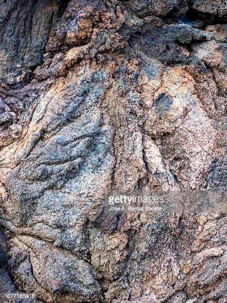 complete setting of the textures of the face of a volcanic rock with lava textures. - volcanic rock stock pictures, royalty-free photos & images