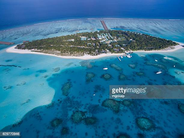 complete view of meeru island and coral reef patches around it - male maldives stock pictures, royalty-free photos & images