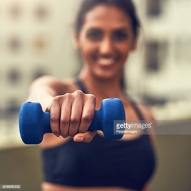 complete your workout with dumbbells - peopleimages stock pictures, royalty-free photos & images