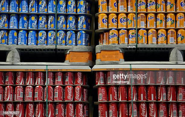Completed aluminium cans produced for AG Barr Plc's Rubicon drink and CocaCola Co's Coke and Fanta drinks sit stored ahead of shipping at Rexam Plc's...