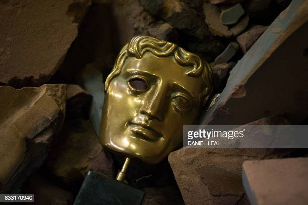 TOPSHOT A completed BAFTA masks is pictured amongst broken moulds during a photocall at the New Pro Foundries west of London on January 31 2017 The...