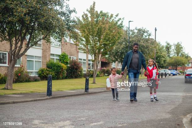 completed the school day - one parent stock pictures, royalty-free photos & images