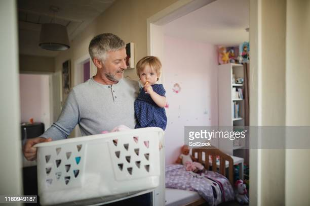 completing daily chores - stay at home father stock pictures, royalty-free photos & images