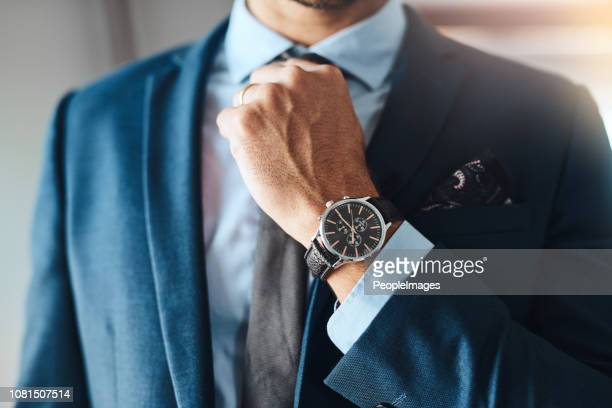 completing his look - wrist watch stock pictures, royalty-free photos & images