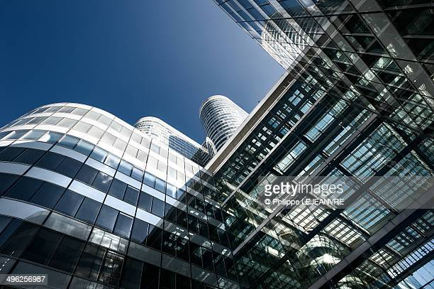Complex building and blue sky at La Défense, Paris