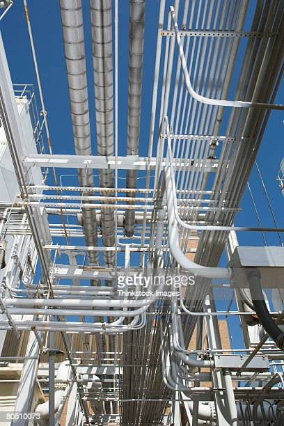 complex piping at waste treatment plant - thinkstock stock photos and pictures