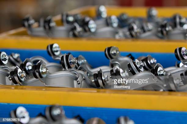 Components for Kia Motors Corp vehicles sit on the production line at the company's plant in Gwangju South Korea on Friday July 8 2016 South Korea is...
