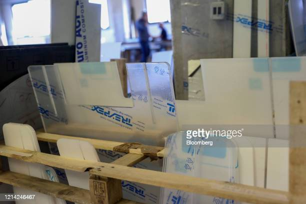Components for plexiglass barriers stand at Plexismart Srl in Guidonia close to Rome Italy on Wednesday May 20 2020 Floortoceiling plexiglass...