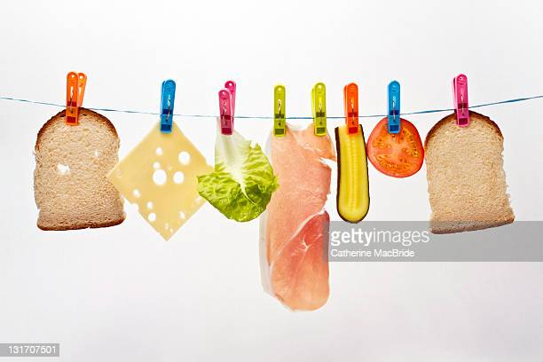 components of sandwich pegged to washing line - catherine macbride stock pictures, royalty-free photos & images