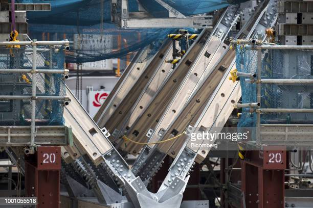 Components of the roof structure for the New National Stadium the main venue for the Tokyo 2020 Olympic and Paralympic Games sit at the construction...