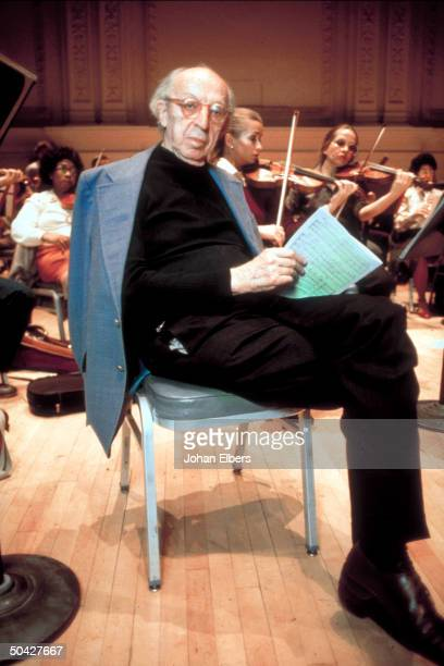 Composer Aaron Copland holding music during rehearsal at Carnegie Hall