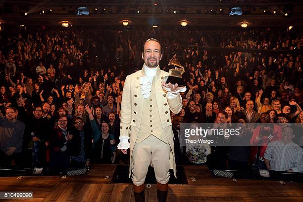 Composer actor LinManuel Miranda celebrates receiving GRAMMY award on stage during Hamilton GRAMMY performance for The 58th GRAMMY Awards at Richard...