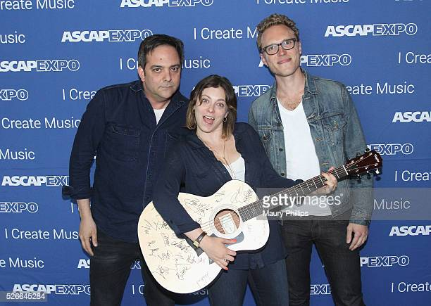 Composer Adam Schlesinger actress/singer Rachel Bloom and Jack Dolgen pose with a #StandWithSongwriters guitar which will be presented in May to...