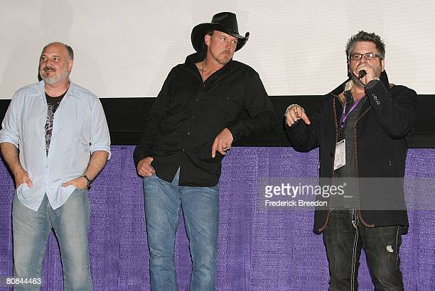Composer Alan Brewer and actor and country music singer Trace Adkins listen as director Steven Goldman fields questions after a screening of 'Trailer...