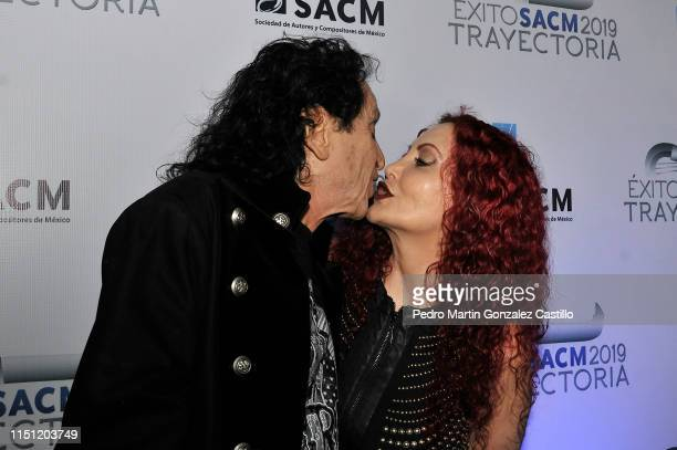 Composer Alex Lora and Celia Lora kiss each other during the Authors and Composers Society 2019 awards at Society of Authors and Composers in the...