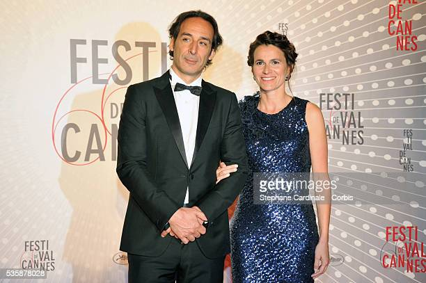 Composer Alexandre Desplat and french culture minister Aurelie Filippetti attend the 'Palme D'Or Winners dinner' during the 66th Cannes International...