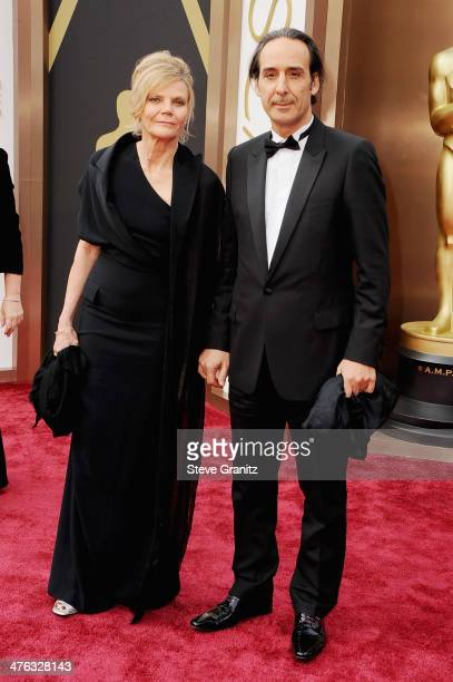 Composer Alexandre Desplat and guest attend the Oscars held at Hollywood Highland Center on March 2 2014 in Hollywood California
