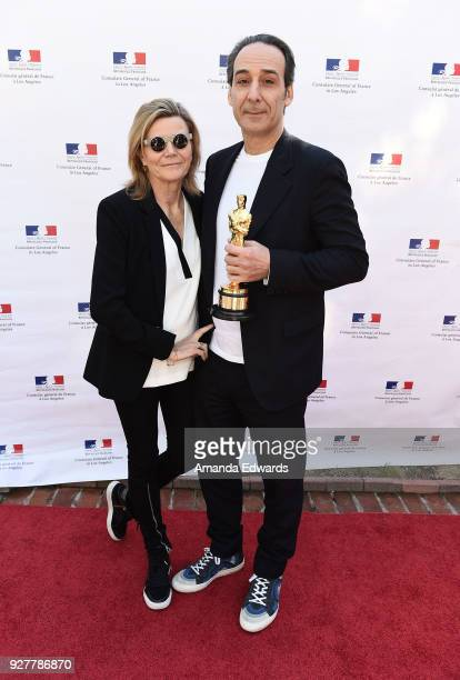 Composer Alexandre Desplat and violinist Dominique Lemonnier attend the 90th Academy Awards French Nominees Reception hosted by the Consul General of...
