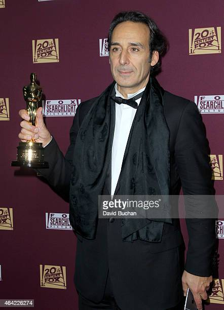 Composer Alexandre Desplat attends the 21st Century Fox and Fox Searchlight Oscar Party at BOA Steakhouse on February 22 2015 in West Hollywood...