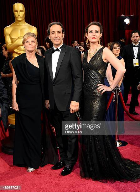 Composer Alexandre Desplat his wife Solre Desplat and daughter Ninon Desplat attend the Oscars held at Hollywood Highland Center on March 2 2014 in...