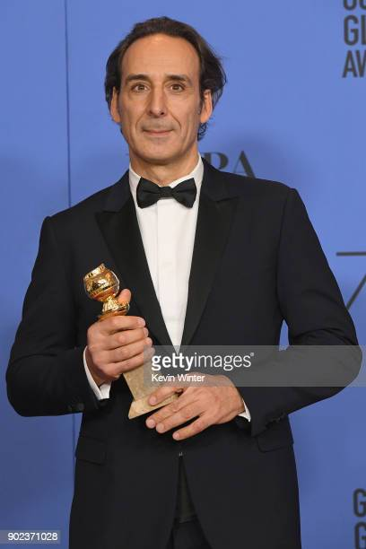 Composer Alexandre Desplat poses with his award for Best Original Score Motion Picture for 'The Shape of Water' in the press room during The 75th...