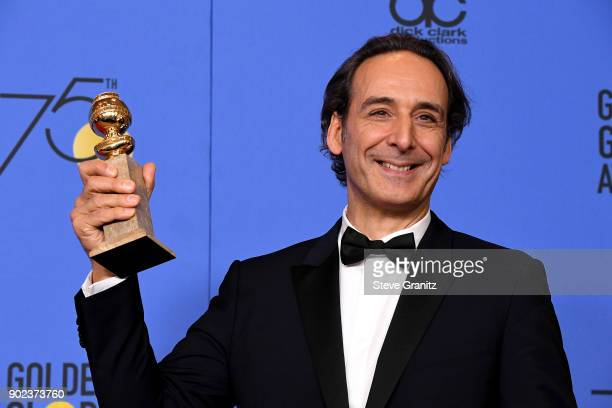 Composer Alexandre Desplat winner of the award for Best Original Score for 'The Shape of Water' attends The 75th Annual Golden Globe Awards at The...