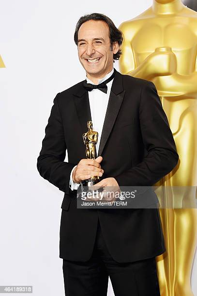 Composer Alexandre Desplat winner of the Best Achievement in Music Written for Motion Pictures, Original Score for 'The Grand Budapest Hotel' poses...