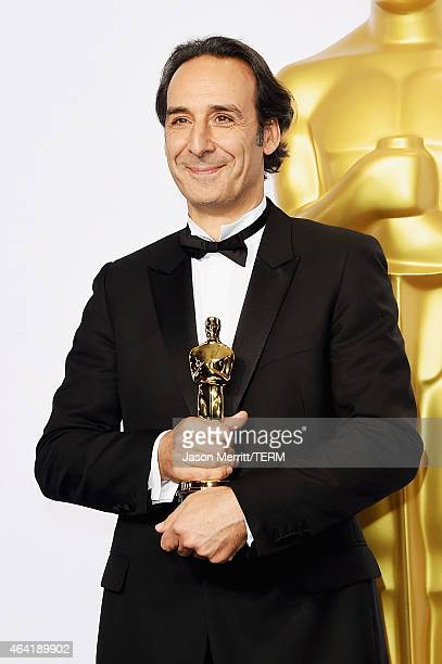 Composer Alexandre Desplat winner of the Best Achievement in Music Written for Motion Pictures Original Score for 'The Grand Budapest Hotel' poses in...