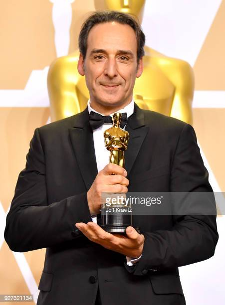Composer Alexandre Desplat winner of the Best Original Music Score for 'Shape of Water' poses in the press room during the 90th Annual Academy Awards...