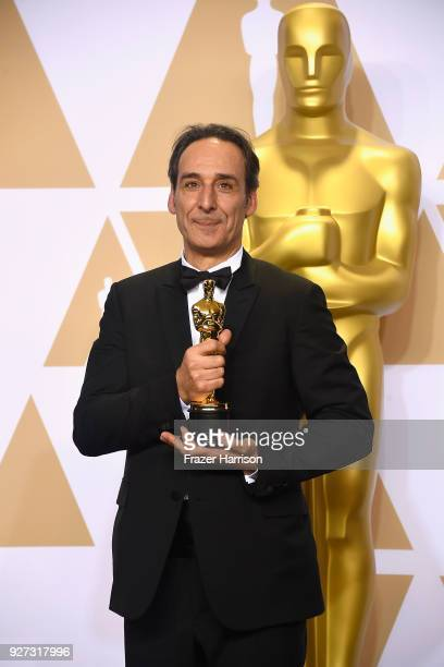 Composer Alexandre Desplat winner of the Best Original Score award for 'The Shape of Water' poses in the press room during the 90th Annual Academy...