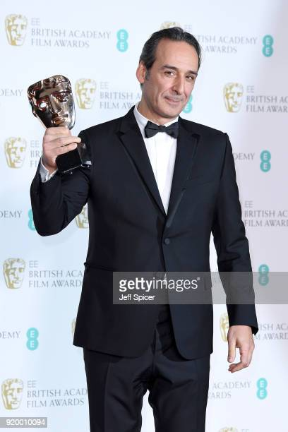 Composer Alexandre Desplat winner of the Original Music award for the movie 'The Shape of Water' poses in the press room during the EE British...
