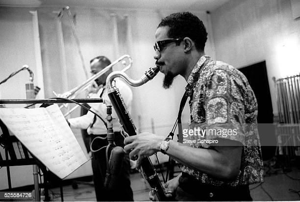 Composer and horn player Eric Dolphy during the recording sessions for George Russell's Ezzthetics album at Riverside Studios David Baker trombonist...