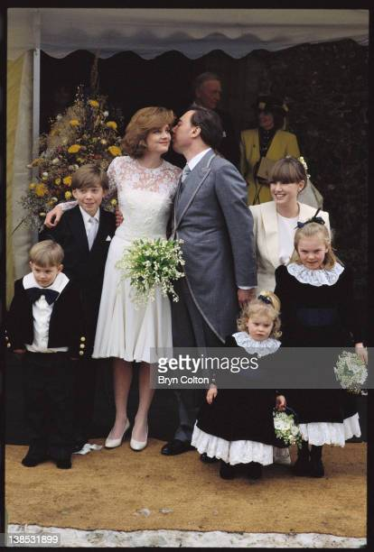 Composer Andrew Lloyd Webber center kisses his wife Madeleine Gurdon left outside Saint Botolphs Church following their marriage blessing ceremony in...