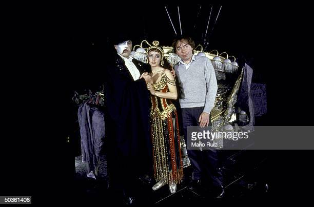 Composer Andrew Lloyd Webber posing with actress/wife Sarah Brightman and actor Michael Crawford both in costume during rehearsal for Webber musical...