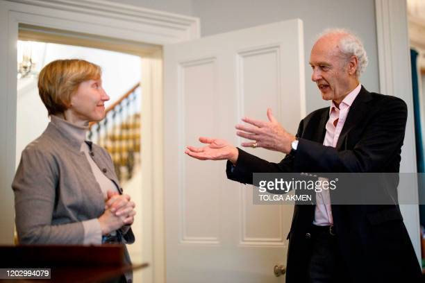 Composer Anthony Bolton gestures toward Marina Litvinenko , widow of murdered Russian ex-spy Alexander Litvinenko, during the press launch of the...