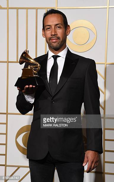 Composer Antonio Sanchez poses with his trophy for Best Score Soundtrack for Visual Media Birdman in the press room during the 58th Annual Grammy...