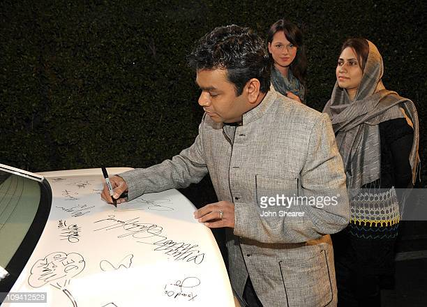 Composer AR Rahman signs a Chrysler 300 at Vanity Fair Campaign Hollywood 2011 continues with the Richard Mille Toasts Fox Searchlight Films held at...