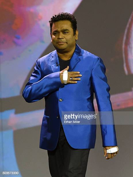 Composer AR Rahman wears Intel Curie smartbands on his wrists to make music using gestures during a keynote address by Intel Corp CEO Brian Krzanich...