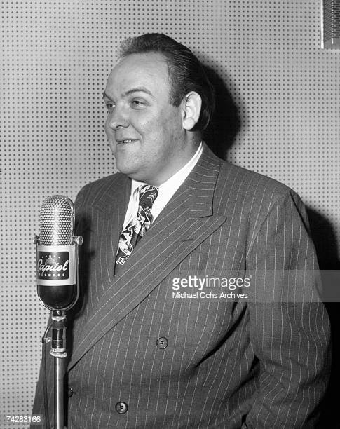 Composer Billy May records in Capitol Records studios on December 10 1945 in Los Angeles California