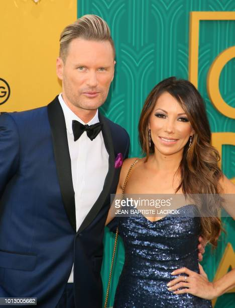 Composer Brian Tyler and guest attend the premiere of Warner Bros Pictures' 'Crazy Rich Asians' in Hollywood California on August 7 2018