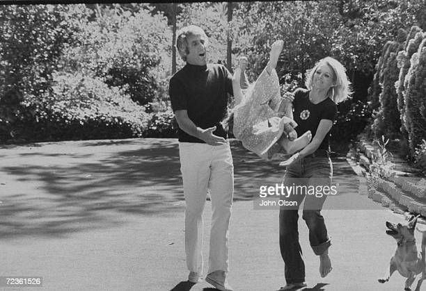 Composer Burt Bacharach Jr and his actress wife Angie Dickinson playing with their daughter