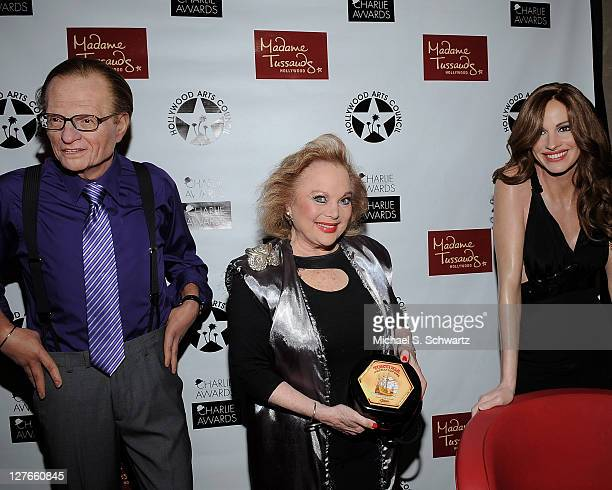 Composer Carol Conners poses with Madame Tussauds waxwork figures of television host Larry King and actress Julia Roberts during the Hollywood Arts...