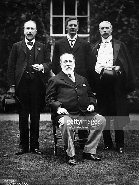 Composer Charles Camille SaintSaens seated at the Gloucester Music Festival with behind him Dr Lloyd Dr Brewer and Dr Elgar