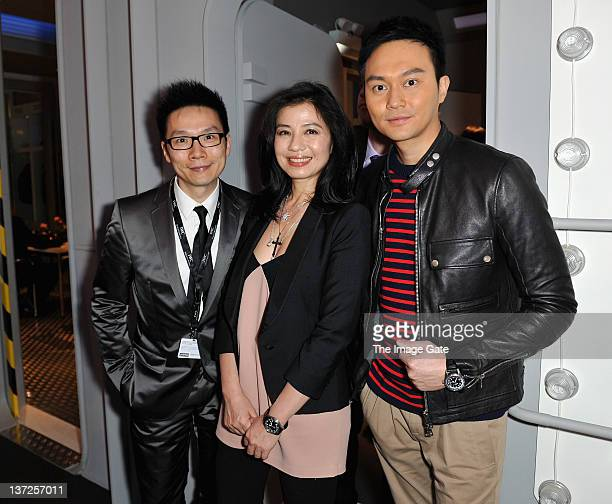 Composer Chiu Tsang Hei and actors Cherie Chung and Julian Cheung visits the IWC Schaffhausen booth during the 22nd SIHH High Jewellery Fair at the...