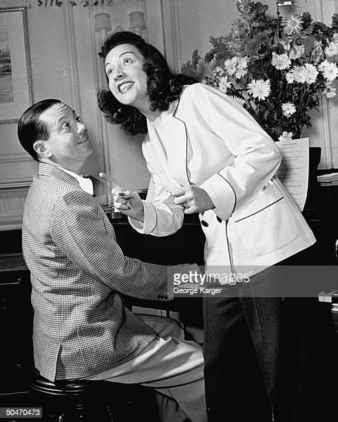 Composer Cole Porter accompanying musical star Ethel Merman as she rehearses one of the songs fr his new Broadwaybound musical Du Barry Was a Lady...