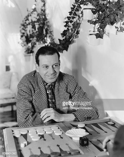 Composer Cole Porter Playing Backgammon