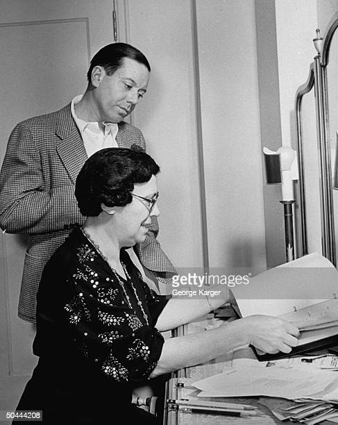 Composer Cole Porter w secy going over script in dressing room backstage at theater during outoftown tryouts for his new Broadwaybound musical Du...