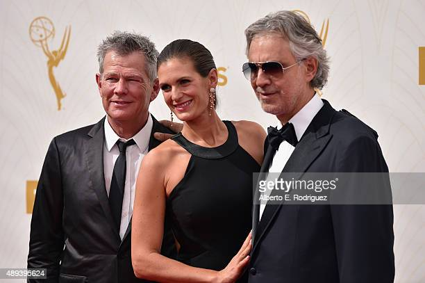 Composer David Foster actress Veronica Berti and recording artist Andrea Bocelli attend the 67th Emmy Awards at Microsoft Theater on September 20...