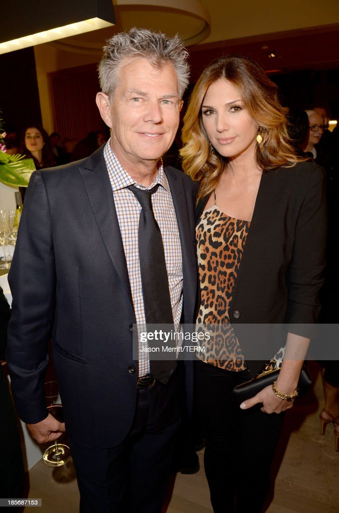 Composer David Foster (L) and Daisy Fuentes celebrate the opening of the new Nespresso Beverly Hills Flagship boutique on October 23, 2013 in Beverly Hills, California. The 7,500 square foot space offers guests the ultimate coffee experience.