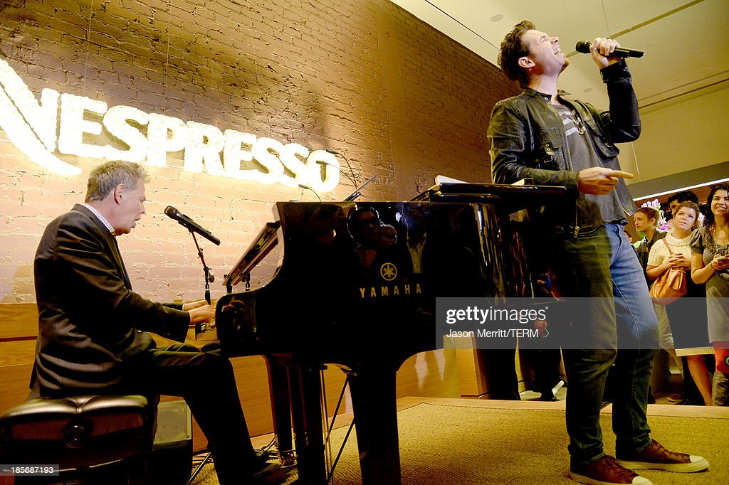 Composer David Foster (L) and singer Michael Johns perform onstage to celebrate the opening of the new Nespresso Beverly Hills Flagship boutique on October 23, 2013 in Beverly Hills, California. The 7,500 square foot space offers guests the ultimate coffee experience.